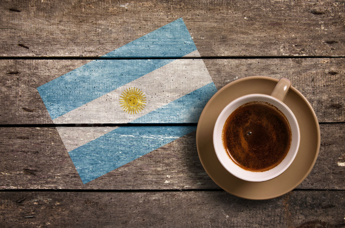 Argentina flag with cup of coffee