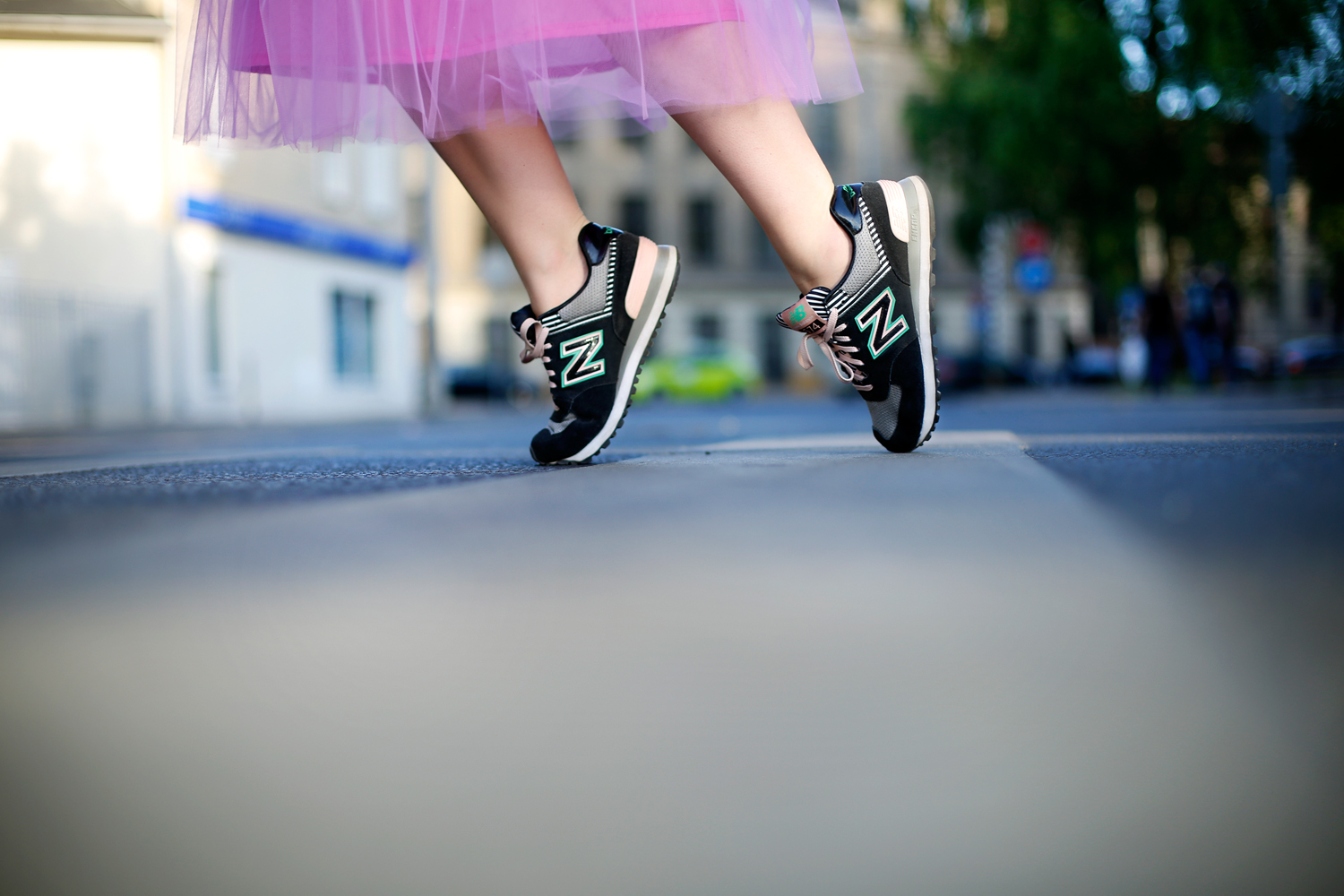 Girl dancing on the street in New Balance sneakers