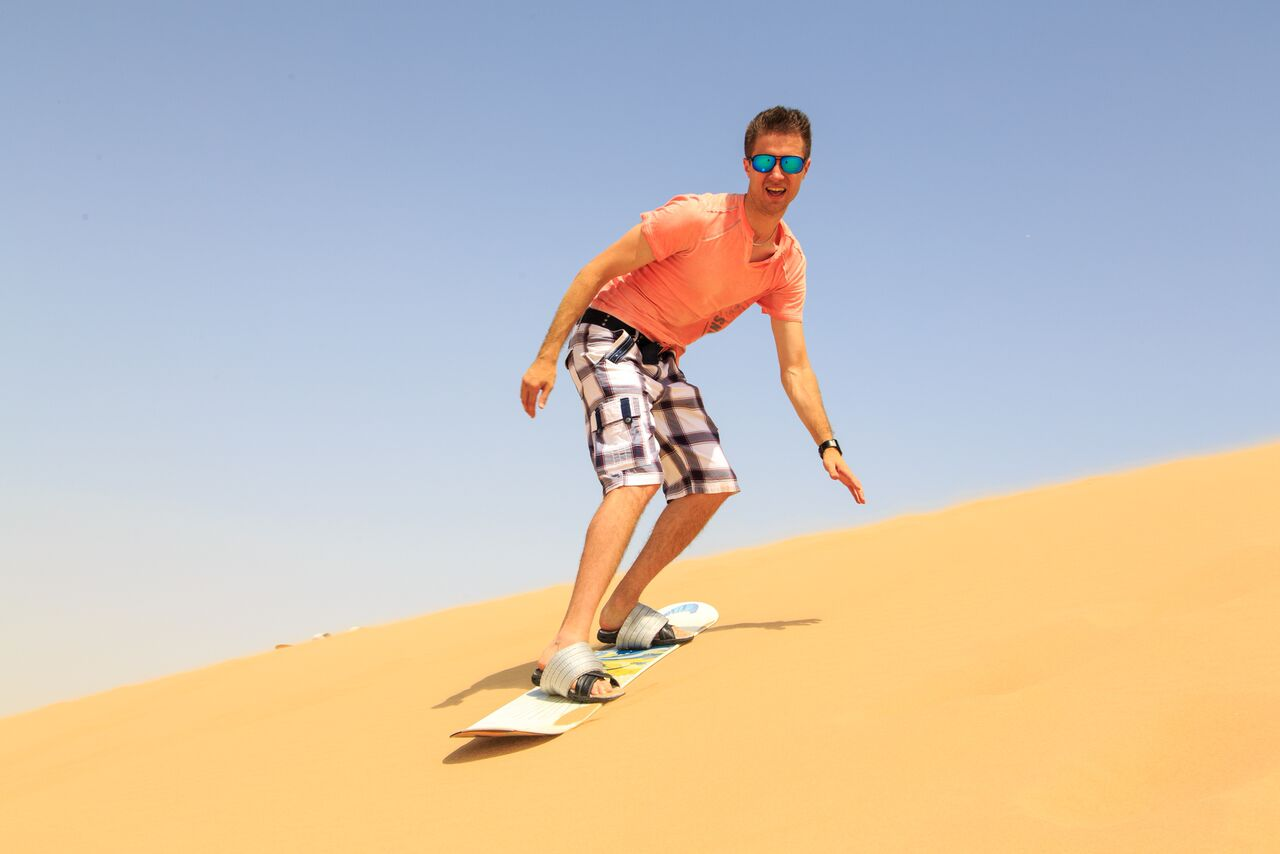 Extreme sand boarding in the desert