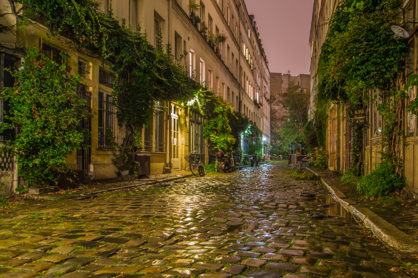 Cute small narrow streets of Paris at night