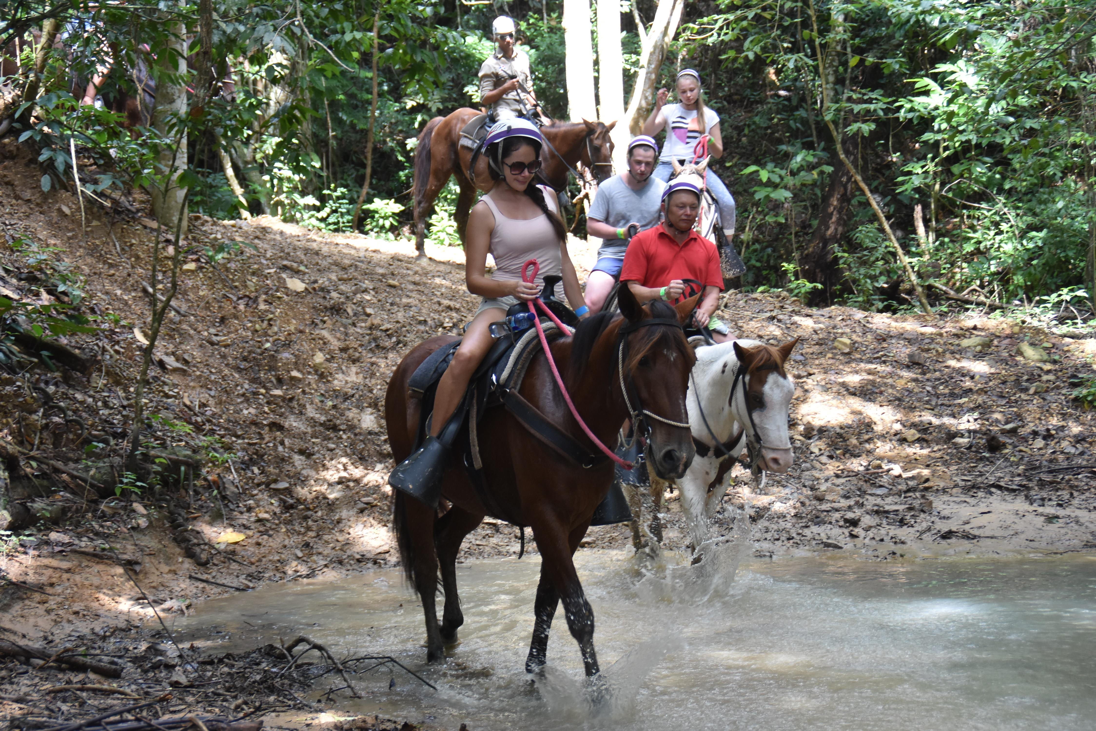 Woman riding a horse in adventure park