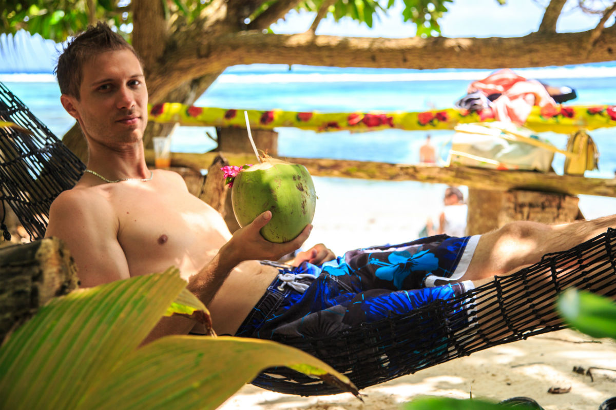 Drinking coconut milk in hammock