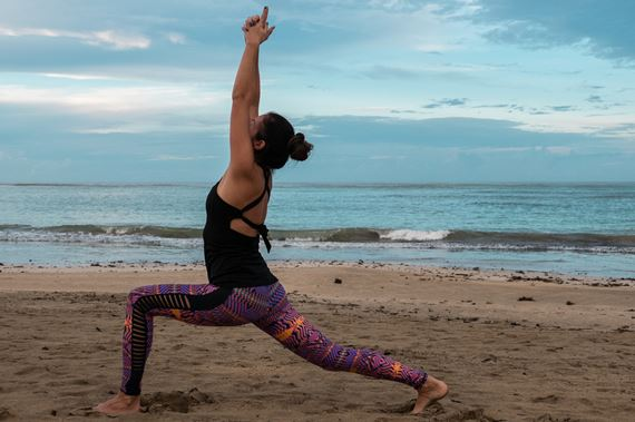 Yoga on the beach at Zoetry Aqua Hotel