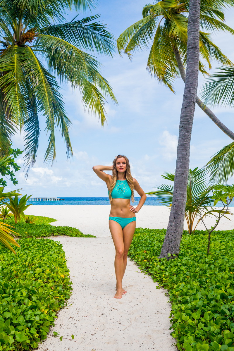 Beautiful girl posing at Maldives beach