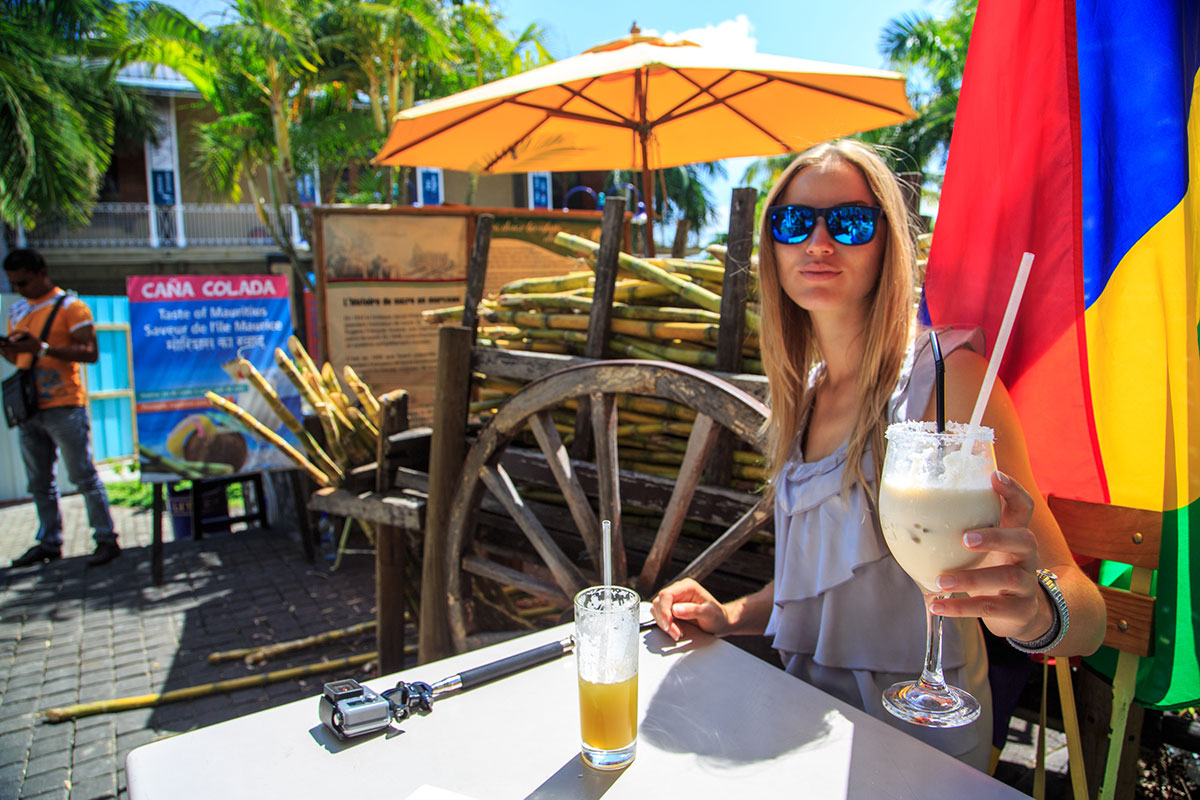 Drinking sugarcane juice on Mauritius