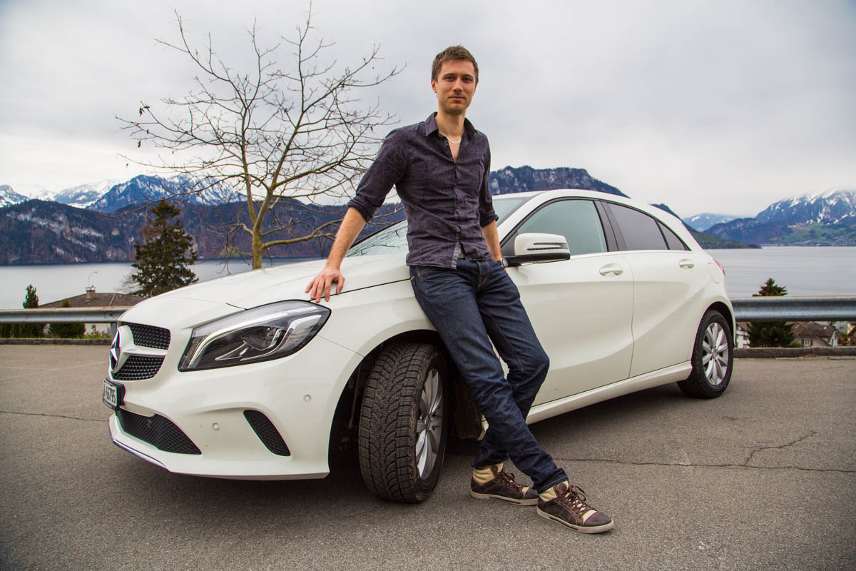 Young man with mercedes car