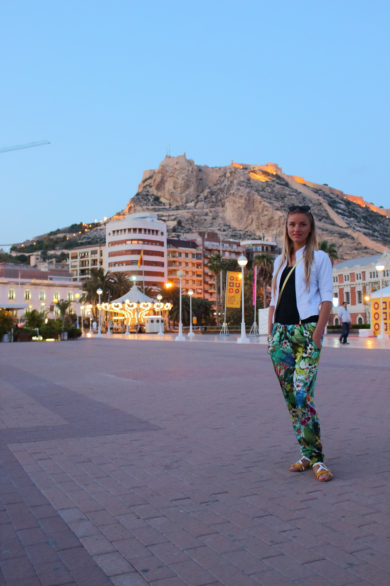 beautiful girl walking down the main promenade in Alicante