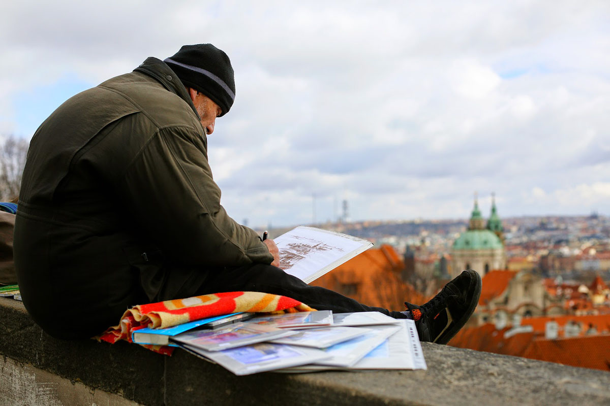 old man drawing Prague beautiful view