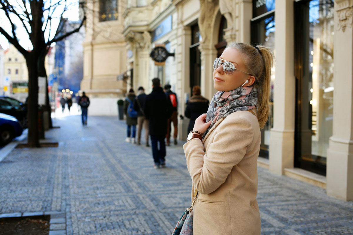 beautiful girl walking on Prague streets