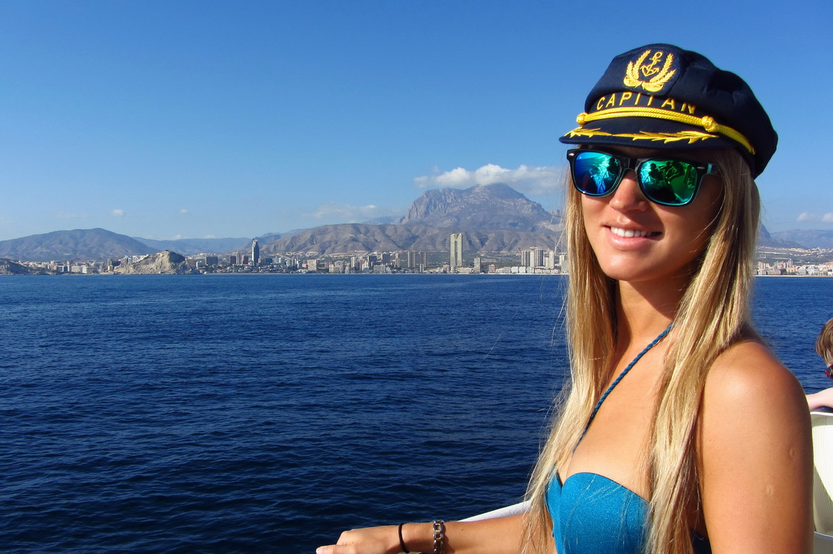 girl with captain hat sailing in Benidorm