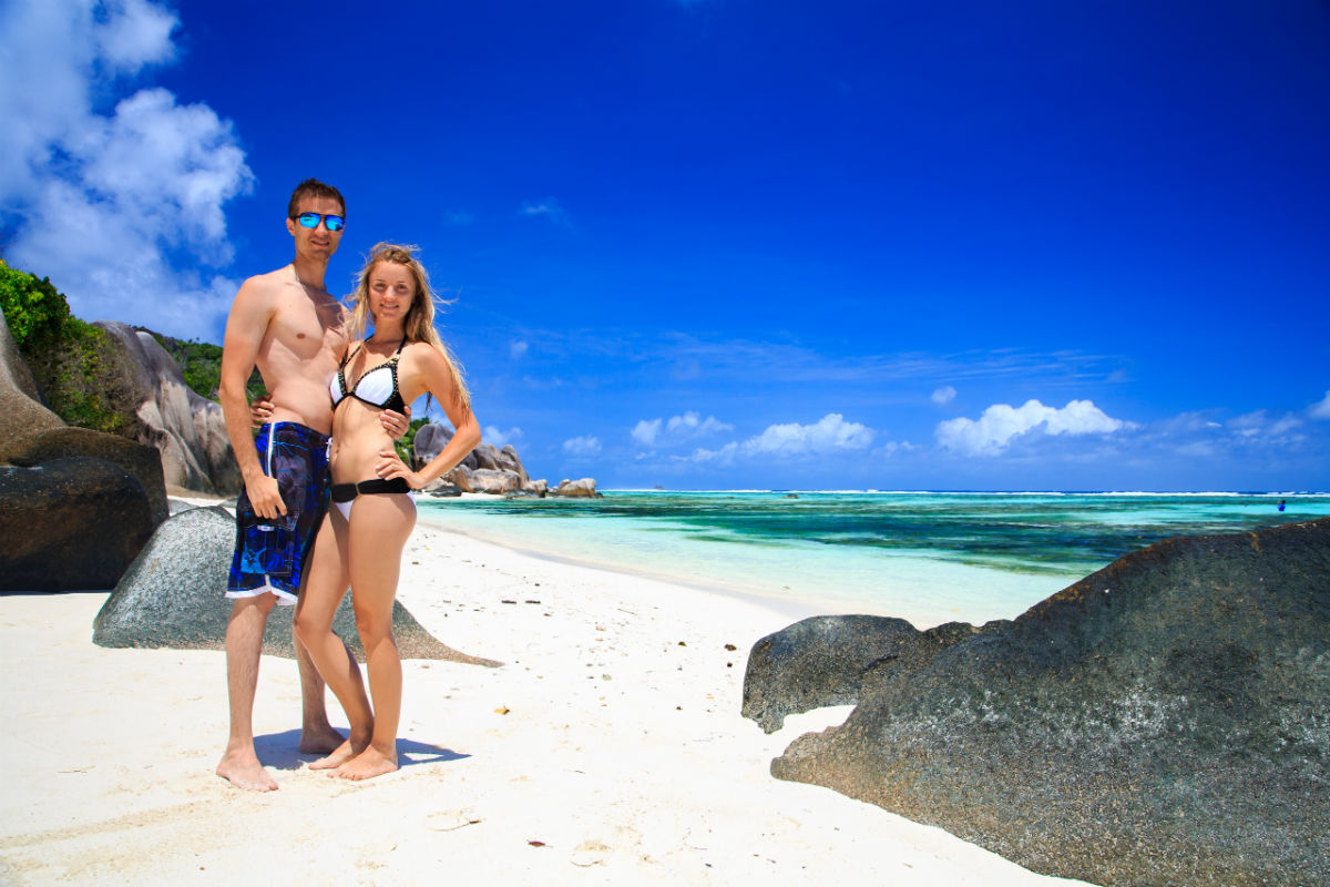 Happy couple on Seychelles beach