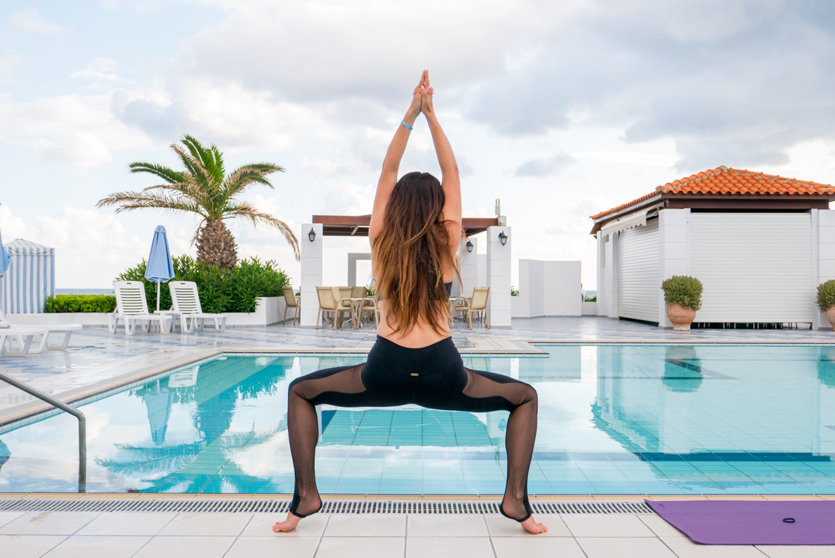 Yoga workout near hotels pool