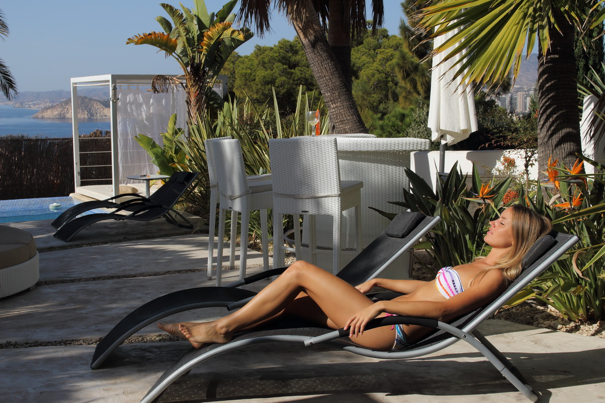 beautiful girl relaxing in Benidorm luxury resort