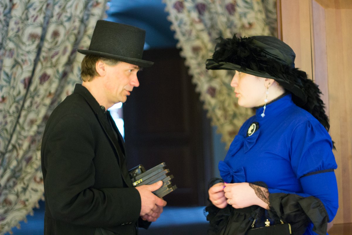 Conversation between man and woman dressed in 19th century clothes