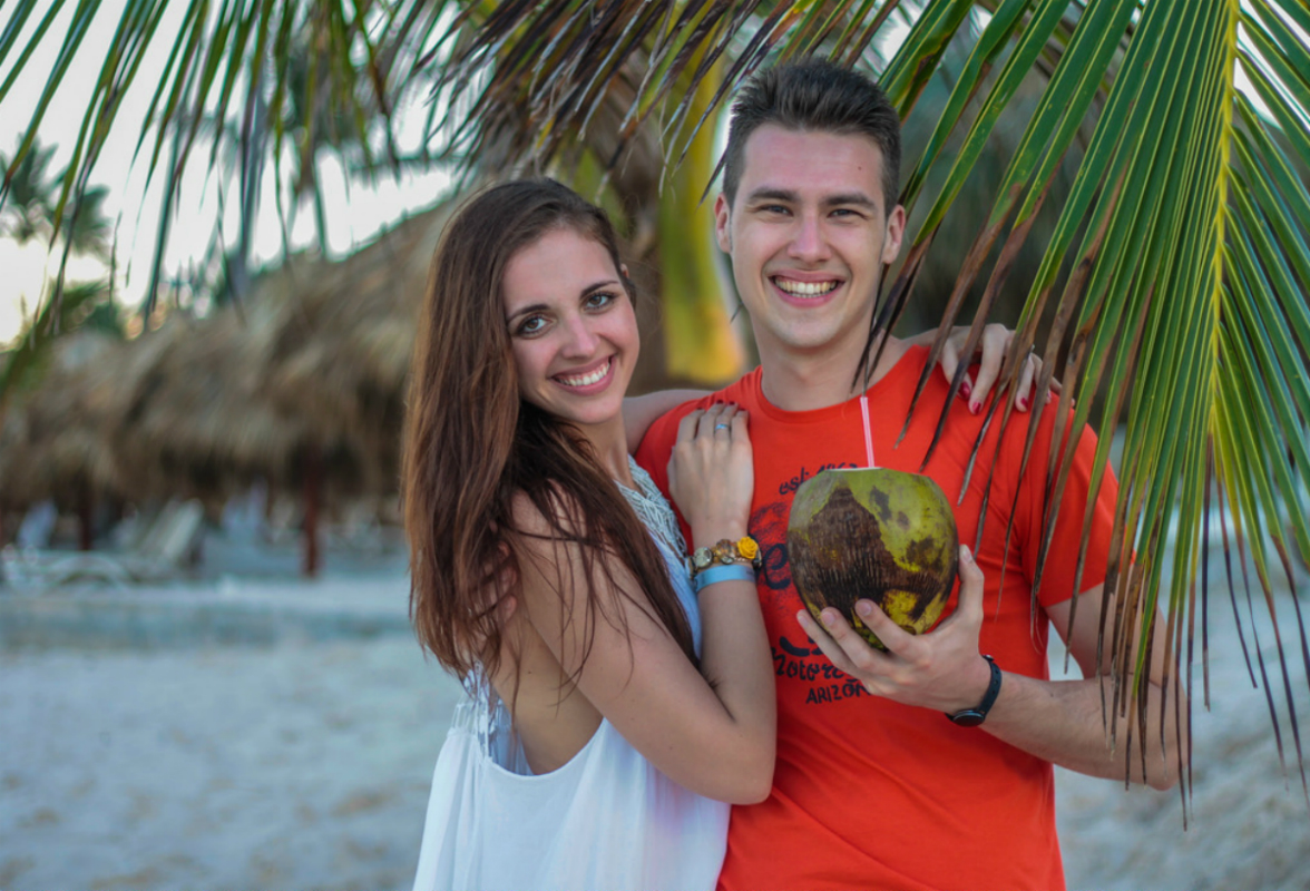 Happy couple with coconut