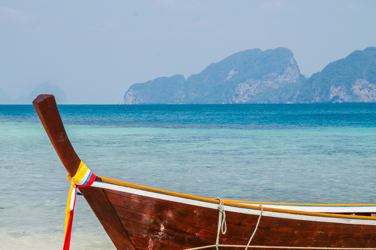 Ocean Thailand longtail boat view rock