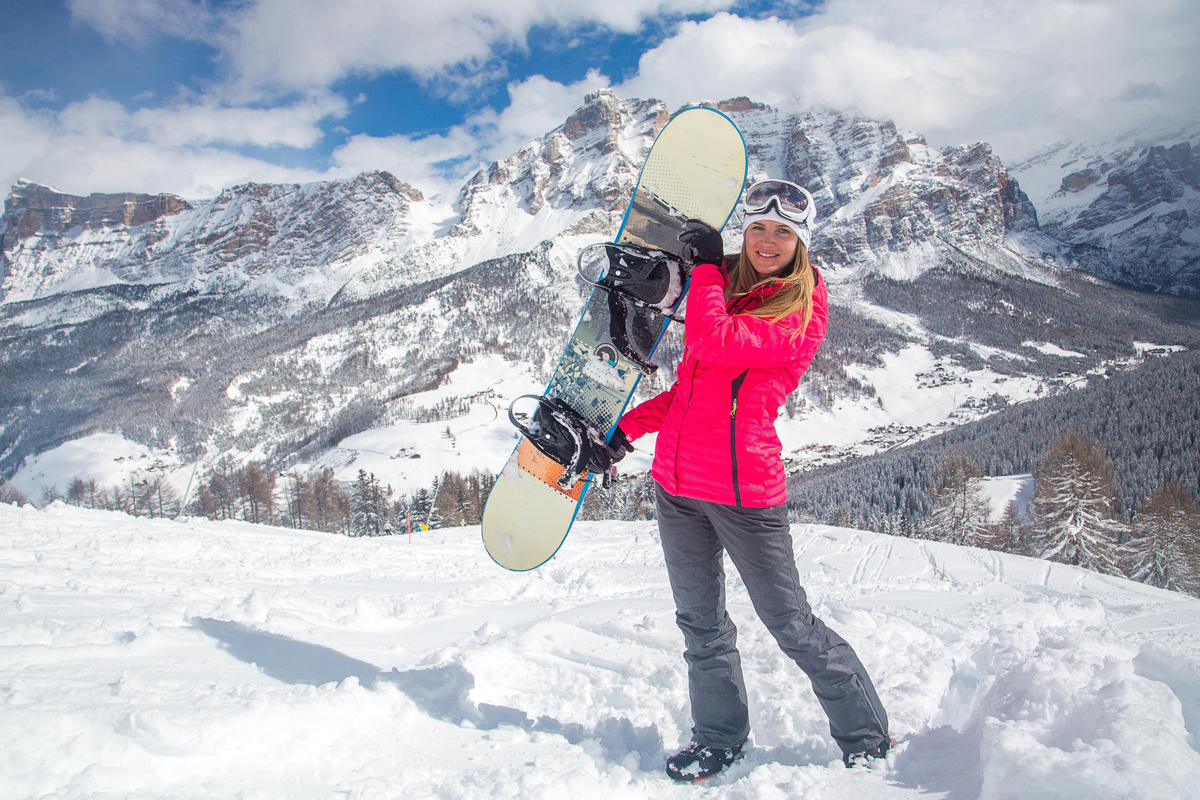 Beautiful girl with snowboard