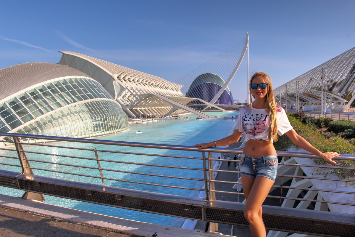beautiful girl walks between futuristic buildings of Valencia