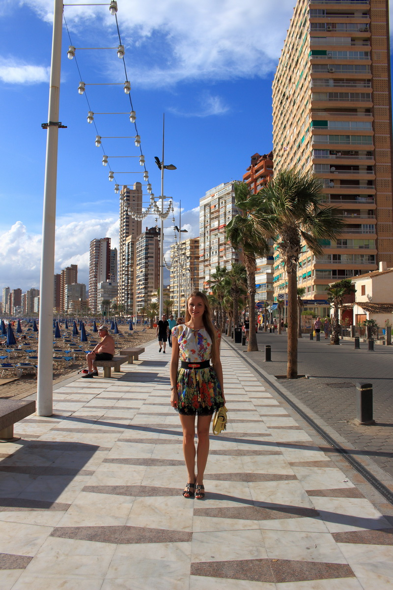 girl walking along the Benidorm promenade
